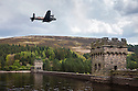 Lancaster bomber at Dam Busters 70th anniversary flypast at Derwent Dam 16th May 2013. 617 Squadron practiced on Derwent Reservoir during World War two before successfully breaching the Mohne and Eder dams in Germany.