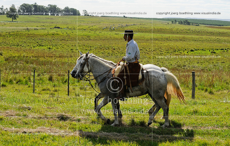 URUGUAY Tacuarembo, Gaucho with two horses on the way to annual Gaucho festival  Fiesta de la Patria de Gaucho in Tacuarembo / URUGUAY Tacuarembo, Gaucho mit zwei Pferden