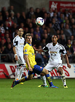 Saturday 28 September 2013<br /> Pictured:  Jonathan de Guzman (R) of Swansea shoots off target.<br /> Re: Barclay's Premier League, Swansea City FC v Arsenal at the Liberty Stadium, south Wales.