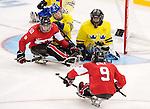 Anthony Gale and Ben Delaney, Sochi 2014 - Para Ice Hockey // Para-hockey sur glace.<br /> Team Canada takes on Sweden in Para Ice Hockey // Équipe Canada affronte la Suède en para-hockey sur glace. 08/03/2014.