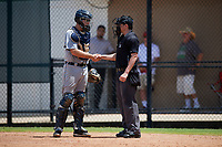 GCL Tigers West catcher David Noworyta (38) shakes hands with umpire Chad Westlake during a Gulf Coast League game against the GCL Phillies West on July 27, 2019 at the Carpenter Complex in Clearwater, Florida.  (Mike Janes/Four Seam Images)