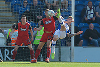 Frankie Kent of Colchester United tries an overhead kick during the Sky Bet League 2 match between Colchester United and Grimsby Town at the Weston Homes Community Stadium, Colchester, England on 19 April 2019. Photo by Alan  Stanford / PRiME Media Images.
