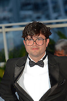 Brazilian director Joao Paulo Miranda Maria poses after being awarded with the Short Film Special Prize at the Palme D'Or Winner Photocall during the 69th annual Cannes Film Festival at the Palais des Festivals on May 22, 2016 in Cannes, France.