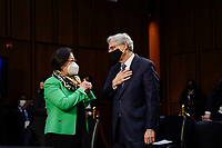 WASHINGTON, DC - FEBRUARY 22:  (L-R) United States Senator Mazie Hirono (Democrat of Hawaii) speaks to Attorney General nominee Merrick Garland as they arrive for Garland's confirmation hearing before the Senate Judiciary Committee in the Hart Senate Office Building on February 22, 2021 in Washington, DC. Garland previously served at the Chief Judge for the U.S. Court of Appeals for the District of Columbia Circuit. <br /> Credit: Drew Angerer / Pool via CNP /MediaPunch