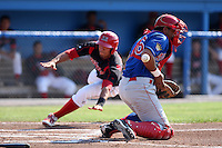 Auburn Doubledays catcher Wilfri Pena #16 blocks a throw as Romulo Ruiz slides in safely behind him during a game against the Batavia Muckdogs at Dwyer Stadium on July 17, 2011 in Batavia, New York.  Batavia defeated Auburn 8-3.  (Mike Janes/Four Seam Images)