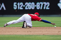 Round Rock Express second baseman Jurickson Profar #10 reaches for the ball after making an error against the Omaha Storm Chasers in the Pacific Coast League baseball game on April 7, 2013 at the Dell Diamond in Round Rock, Texas. Omaha beat Round Rock 5-2, handing the Express their first loss of the season. (Andrew Woolley/Four Seam Images).