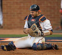 Catcher Franco Valdes #33 of the Virginia Cavaliers reacts after taking a pitch off his mask against the St. John's Red Storm in the championship game of the Charlottesville Regional at Davenport Field on June 7, 2010, in Charlottesville, Virginia.  The Cavaliers defeated the Red Storm 5-3.  Photo by Brian Westerholt / Four Seam Images