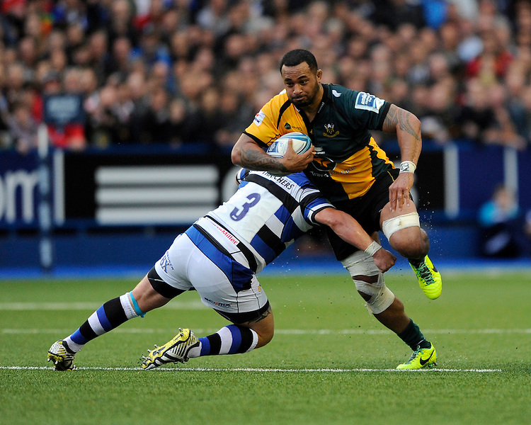 Samu Manoa of Northampton Saints is tackled at full pace by David Wilson of Bath Rugby during the Amlin Challenge Cup Final match between Bath Rugby and Northampton Saints at Cardiff Arms Park on Friday 23rd May 2014 (Photo by Rob Munro)