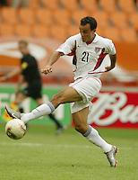 Landon Donovan stretches for the ball. The USA tied South Korea, 1-1, during the FIFA World Cup 2002 in Daegu, Korea.