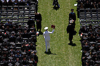 3 June 2011, Cambridge, MA - MIT Commencement...Graduating students return to their seats in Killian Court after receiving their diplomas at the 2011 Massachusetts Institute of Technology commencement ceremony.....Photo by M. Scott Brauer for MIT News