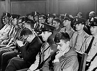 Richard Bizier; Student and  other<br /> FLQ Bomb suspects sit in court today surrounded by Montreal and Quebec provincial police. FLQ is a terrorist organization dedicated to the removal of Quebec from Confederation. The suspects for the most part were young and shabbily dressed. They all were in need of haircuts.<br /> <br /> <br /> 1963<br /> <br /> PHOTO :  Frank Grant - Toronto Star Archives - AQP