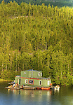 Houseboat set against Joliffe Island in Yellowknife Bay