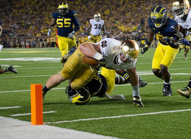 Irish tight end Troy Niklas (85) dives into the end zone for a touchdown as Michigan Wolverines safety Jarrod Wilson (22) defends in the third quarter.<br /> <br /> Photo by Matt Cashore