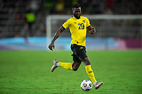 ORLANDO, FL - JULY 20: Kemar Lawrence #20 of Jamaica dribbles the ball during a game between Costa Rica and Jamaica at Exploria Stadium on July 20, 2021 in Orlando, Florida.