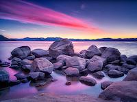 Boulder rocks and sunset on shoreline of Chimney Beach. Lake Tahoe, Nevada