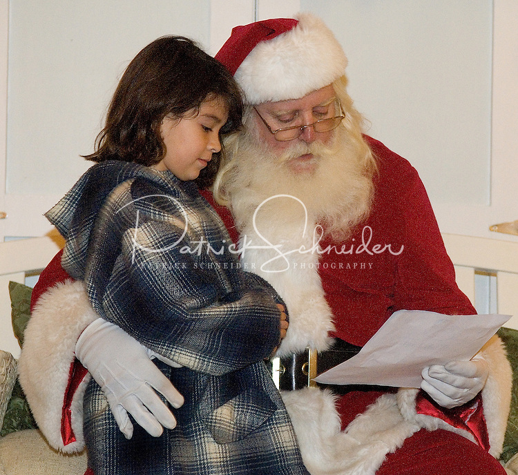 A young girl goes over her wish list with Santa during the annual Christmas tree lighting event at Birkdale Village in Huntersville, NC. Birkdale Village combines the best of shopping, dining, apartments and entertainment venues within a 52-acre mixed-use development.