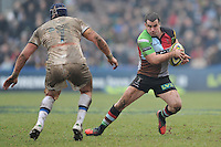 20130309 Copyright onEdition 2013©.Free for editorial use image, please credit: onEdition..Dave Ward of Harlequins  side steps Carl Fearns of Bath Rugby during the LV= Cup semi final match between Harlequins and Bath Rugby at The Twickenham Stoop on Saturday 9th March 2013 (Photo by Rob Munro)..For press contacts contact: Sam Feasey at brandRapport on M: +44 (0)7717 757114 E: SFeasey@brand-rapport.com..If you require a higher resolution image or you have any other onEdition photographic enquiries, please contact onEdition on 0845 900 2 900 or email info@onEdition.com.This image is copyright onEdition 2013©..This image has been supplied by onEdition and must be credited onEdition. The author is asserting his full Moral rights in relation to the publication of this image. Rights for onward transmission of any image or file is not granted or implied. Changing or deleting Copyright information is illegal as specified in the Copyright, Design and Patents Act 1988. If you are in any way unsure of your right to publish this image please contact onEdition on 0845 900 2 900 or email info@onEdition.com