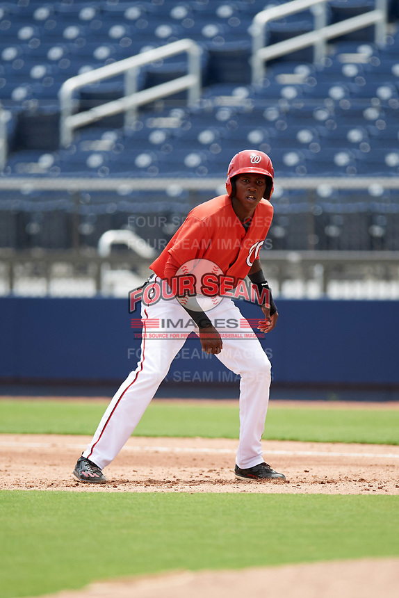 GCL Nationals third baseman Juan Pascal (19) leads off first base during the second game of a doubleheader against the GCL Mets on July 22, 2017 at The Ballpark of the Palm Beaches in Palm Beach, Florida.  GCL Mets defeated the GCL Nationals 4-1.  (Mike Janes/Four Seam Images)