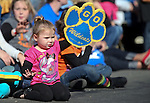 Rilee Blaire, 2, waves as the Western Nevada College Wildcats softball team walks by in the 75th annual Nevada Day parade in Carson City, Nev., on Saturday, Oct. 26, 2013.<br /> Photo by Cathleen Allison