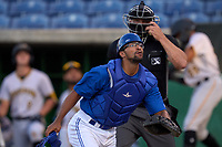 Dunedin Blue Jays catcher Anthony Morales (4) tracks a foul ball during a game against the Bradenton Marauders on May 15, 2021 at BayCare Ballpark in Clearwater, Florida.  The umpire is Casey James.  (Mike Janes/Four Seam Images)