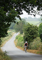 27 JUL 2013 - CROMER, GBR - Richard Clark climbs a hill during The Anglian Triathlon held around Cromer, North Norfolk, Great Britain (PHOTO COPYRIGHT © 2013 NIGEL FARROW, ALL RIGHTS RESERVED)