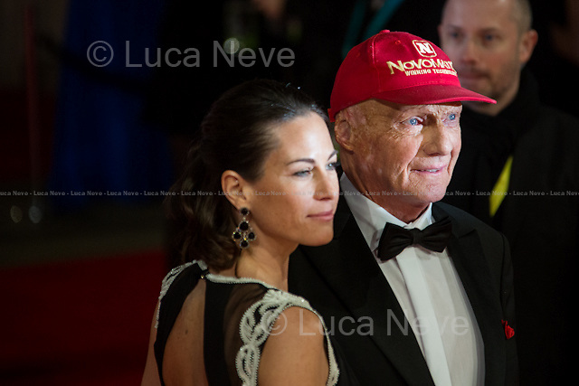 Niki Lauda (Former Formula One racing driver) & Birgit Wetzinger (Niki Lauda wife).<br /> <br /> London, 16/02/2014. Red Carpet of the 2014 EE BAFTA (British Academy of Film and Television Arts) Awards Ceremony, held at the Royal Opera House in London.