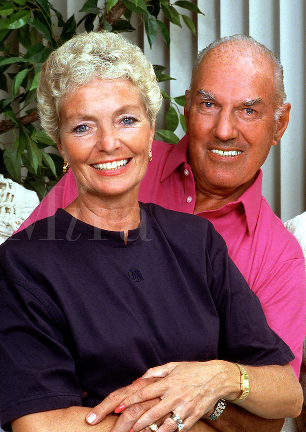 Portrait of smiling, mature couple in an affectionate pose.