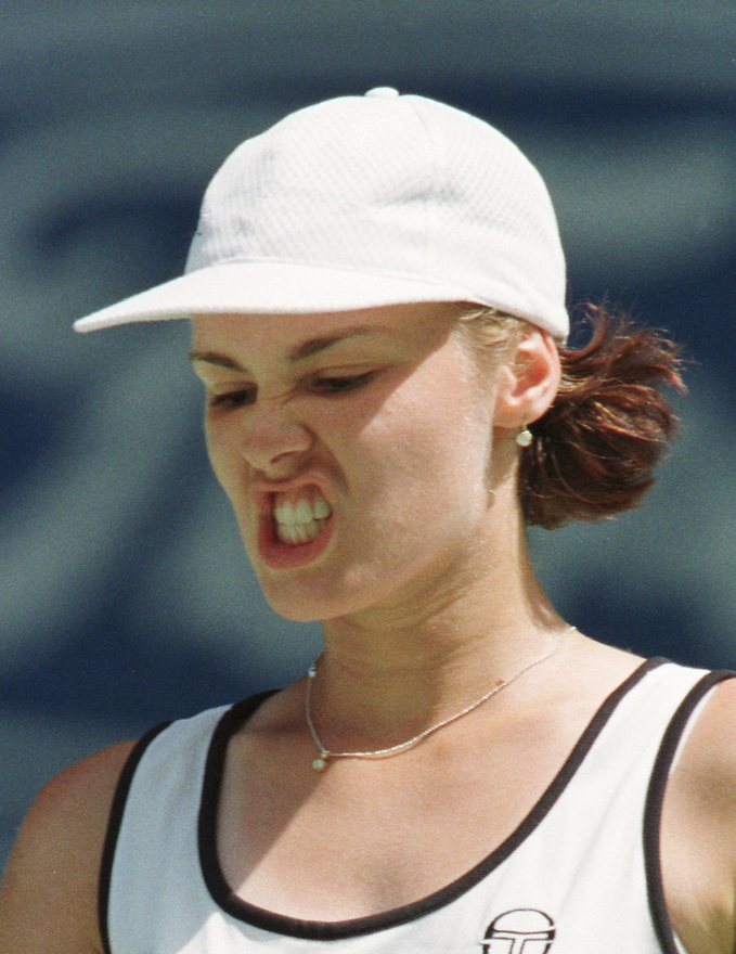 Martina Hingis of Switzerland gestures duirng her semi-final match against American Monica Seles at the Australian Open Tennis Championships in Melbourne, Australia, Thursday, January 28, 1999. Hingis won the match 6-2, 6-4, and will play Amelie Mauresmo of France in the final. (AP Photo/Trevor Collens)