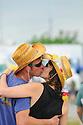 Jazz Fest goers kiss, 2010