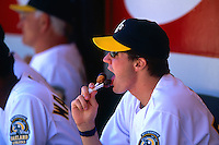 OAKLAND, CA - Barry Zito of the Oakland Athletics licks some lollipops during a game against the Anaheim Angels at the Oakland Coliseum in Oakland, California on July 23, 2000. Photo by Brad Mangin