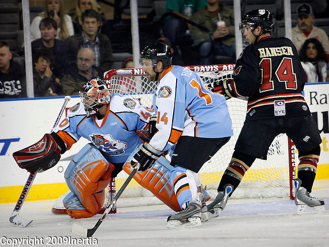 RAPID CITY, SD -- OCTOBER 16, 2009 -- Goaltender Mike Gorman #40 and Tyler Fleck #14 of the Missouri Mavericks guard the net as Rich Hansen #14 of the Rapid City Rush waits for a possible rebound during their game Friday evening in Rapid City, S.D.  (Photo by Dick Carlson/Inertia)