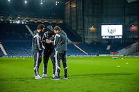 WEST BROMWICH, ENGLAND - FEBRUARY 11:  ( L-R ) Angel Rangel, Jordi Amat and Nelson Oliveira of Swansea City chat on the pitch prior to  the Premier League match between West Bromwich Albion and Swansea City at The Hawthorns on February 11, 2015 in West Bromwich, England. (Photo by Athena Pictures/Getty Images)