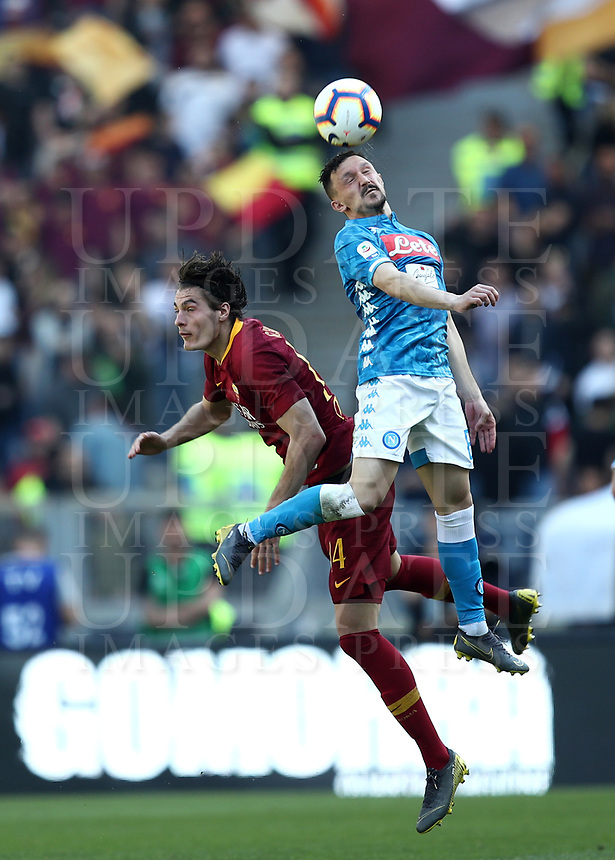 Football, Serie A: AS Roma - SSC Napoli, Olympic stadium, Rome, March 31, 2019. <br /> Napoli's Mario Rui (r) in action with Roma's Patrik Schck (l) during the Italian Serie A football match between Roma and Napoli at Olympic stadium in Rome, on March 31, 2019.<br /> UPDATE IMAGES PRESS/Isabella Bonotto