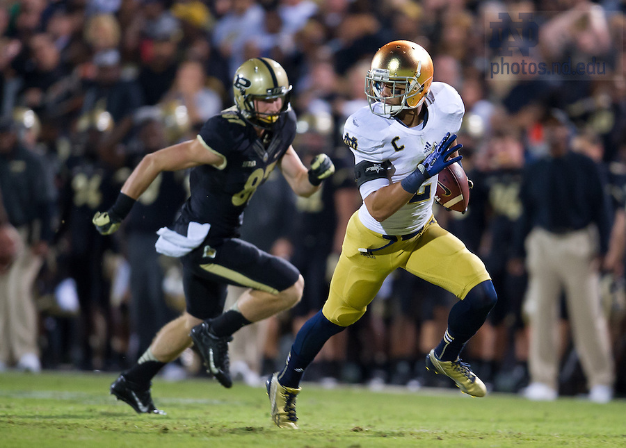 Sept. 14, 2013; Bennett Jackson (2) heads for the end zone for a pick-six after intercepting a pass intended for Purdue Boilermakers wide receiver Shane Mikeskey (87).<br /> <br /> Photo by Matt Cashore