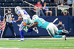 Miami Dolphins defensive end Andre Branch (50) and Dallas Cowboys linebacker Alfred Morris (46) in action during the pre-season game between the Miami Dolphins and the Dallas Cowboys at the AT & T stadium in Arlington, Texas.