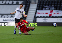 12th September 2020; Pride Park, Derby, East Midlands; English Championship Football, Derby County versus Reading; Andy Rinomhota of Reading does a sliding tackle on Craig Forsyth of Derby County to kick the ball out of play