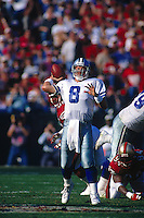 SAN FRANCISCO, CA - Quarterback Troy Aikman of the Dallas Cowboys in action during a game against the San Francisco 49ers at Candlestick Park in San Francisco, California in 1996. Photo by Brad Mangin.