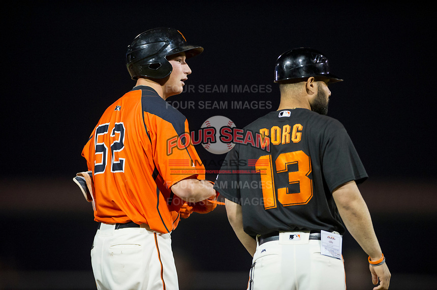 AZL Giants third baseman Jacob Gonzalez (52) stands on third base as he talks to manager Hector Borg during a game against the AZL Cubs on September 5, 2017 at Scottsdale Stadium in Scottsdale, Arizona. AZL Cubs defeated the AZL Giants 10-4 to take a 1-0 lead in the Arizona League Championship Series. (Zachary Lucy/Four Seam Images)