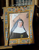 A tapestry depicting Spaniard Candida Maria de Jesus y Cipitria Barriola hangs on the facade of Saint Peter's Basilica during a canonization mass in St. Peter's square, Vatican, 17 October 2010. The pope formally recognized Australia's first saint, Sister Mary MacKillop, who is revered as a pioneer of education in Outback Australia and the founder of the Sisters of St Joseph of the Sacred Heart. She was canonised along with Stanislaw Soltys of Poland, Andre Bessette of Canada, Candida Maria de Jesus Cipitria y Barriola of Spain, and Italians Giulia Salzano and Battista da Varano