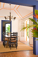 Private home in Parati Brazil. View of the dinning room through a doorway.