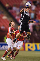 Red Bulls forward (7) Mike Magee and forward (15) Dema Kovalenko watch as DC United forward (11) Alecko Eskandarian hheads the ball. DC United and the NY Red Bulls played to a 0-0 in an MLS regular season match at Giants Stadium, East Rutherford, NJ, August 16, 2006.
