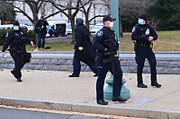 Washington, DC - January 6, 2021: Additional police arrive to protect the US Capitol as thousands of protesters in support of President Donald Trump surround the U.S. Capitol building January 6, 2021.  (Photo by Don Baxter/Media Images International)