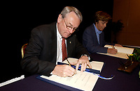 June 3, 2002, Montreal, Quebec, Canada; <br /> <br /> Louis Beaudoin, Quebec State Minister, International Relations (R)<br />  Richard Pound, Chairman of the World Anti-<br /> Doping Agency (L)   sign an agreemeent regarding the Agency's new headquarter in Montreal, June 3, 2002<br /> <br /> <br /> (Mandatory Credit: Photo by Sevy - Images Distribution (©) Copyright 2002 by Sevy<br /> <br /> NOTE :  D-1 H original JPEG, saved as Adobe 1998 RGB