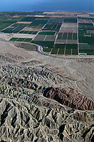 aerial photograph from the mountains in eastern Riverside County toward farming fields and Salton Sea, California