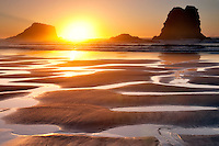 Sunset with low tide reflecting pools.Samuel H. Boardman State Scenic Corridor. Oregon