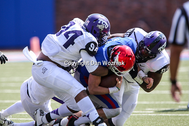Southern Methodist Mustangs quarterback Garrett Krstich (14) and \TCU Horned Frogs defensive end Josh Carraway (94) and TCU Horned Frogs defensive tackle Tevin Lawson (99) in action during the game between the TCU Horned Frogs and the SMU Mustangs at the Gerald J. Ford Stadium in Fort Worth, Texas. TCU defeats SMU 56 to 0.
