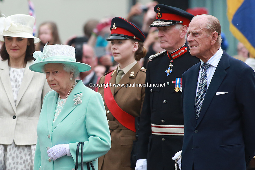 Britain's Queen Elizabeth II and the Duke of Edinburgh gather outside the Coleraine town hall to pay their respects to the dead of World War 1as they finish their three day tour of Northern Ireland, Wednesday June 25, 2014. Photo/Paul McErlane