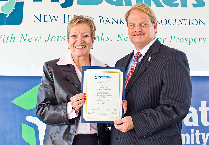 MANASQUAN, NJ — Oct. 1, 2013 — Maureen Mulligan, Executive Director of Coastal Habitat for Humanity (left) presents Robert A. Hart, Senior Vice President of Manasquan Savings Bank a certificate from the NJ Bankers Association for Manasquan Saving's steadfast efforts to help Coastal Habitat for Humanity rebuild homes devastated by Hurricane Sandy.