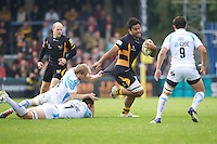 Billy Vunipola of London Wasps forces his way past Matt Kvesic (left) and Sam Betty of Worcester Warriors during the Aviva Premiership match between London Wasps and Worcester Warriors at Adams Park on Sunday 7th October 2012 (Photo by Rob Munro)