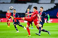 13th April 2021; Parc de Princes, Paris, France; UEFA Champions League football, quarter-final; Paris Saint Germain versus Bayern Munich;  Benjamin Pavard (Bayern) clears from Julian Draxler (PSG)